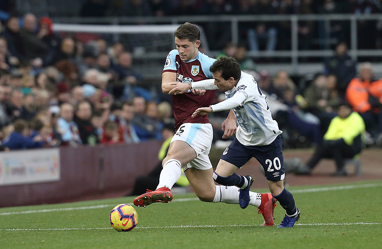 Burnley's James Tarkowski battles with Everton's Bernard<br /> <br /> Photographer Rich Linley/CameraSport<br /> <br /> The Premier League - Burnley v Everton - Wednesday 26th December 2018 - Turf Moor - Burnley<br /> <br /> World Copyright © 2018 CameraSport. All rights reserved. 43 Linden Ave. Countesthorpe. Leicester. England. LE8 5PG - Tel: +44 (0) 116 277 4147 - admin@camerasport.com - www.camerasport.com