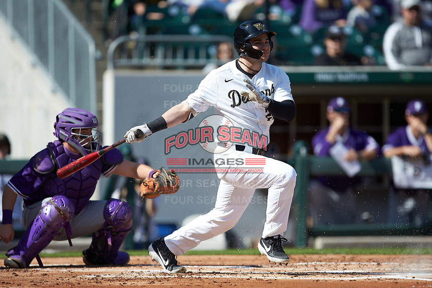 Michael Ludowig (22) of the Wake Forest Demon Deacons follows through on his swing against the Furman Paladins at BB&T BallPark on March 2, 2019 in Charlotte, North Carolina. The Demon Deacons defeated the Paladins 13-7. (Brian Westerholt/Four Seam Images)
