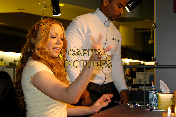"MARIA CAREY.meets fans and signs copies of her award-winning album ""The Emancipation Of Mimi: Ultra Platinum Edition"".at HMV Oxford Street .London England 4 December 2005.Ref:HT.www.capitalpictures.com.sales@capitalpictures.com.©Capital Pictures"
