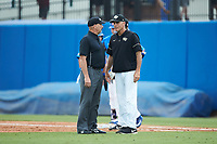 Wake Forest Demon Deacons head coach Tom Walter (16) discusses a call with first base umpire Randy Sutton during the game against the Florida Gators in Game Three of the Gainesville Super Regional of the 2017 College World Series at Alfred McKethan Stadium at Perry Field on June 12, 2017 in Gainesville, Florida. The Gators defeated the Demon Deacons 3-0 to advance to the College World Series in Omaha, Nebraska. (Brian Westerholt/Four Seam Images)