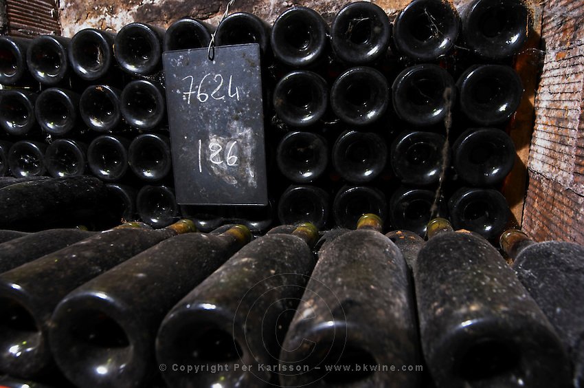 old bottles in the cellar chalk board domaine doudet naudin savigny-les-beaune cote de beaune burgundy france