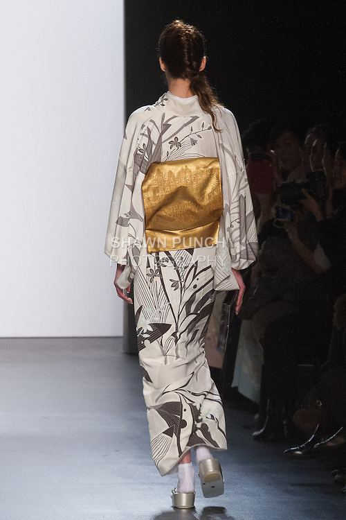 """Model walks runway in an """"Origin of the Universe"""" silk kimono from the Hiromi Asai Fall Winter 2016 """"Spirit of the Earth"""" collection by Hiromi Asai & Kimono Artisan Kyoto, presented at NYFW: The Shows Fall 2016, during New York Fashion Week Fall 2016."""