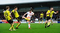 Blackpool's Matty Virtue has a shot under pressure from Burton Albion's Kieran Wallace, left, and Burton Albion's Jake Buxton<br /> <br /> Photographer Chris Vaughan/CameraSport<br /> <br /> The EFL Sky Bet League One - Burton Albion v Blackpool - Saturday 16th March 2019 - Pirelli Stadium - Burton upon Trent<br /> <br /> World Copyright &copy; 2019 CameraSport. All rights reserved. 43 Linden Ave. Countesthorpe. Leicester. England. LE8 5PG - Tel: +44 (0) 116 277 4147 - admin@camerasport.com - www.camerasport.com