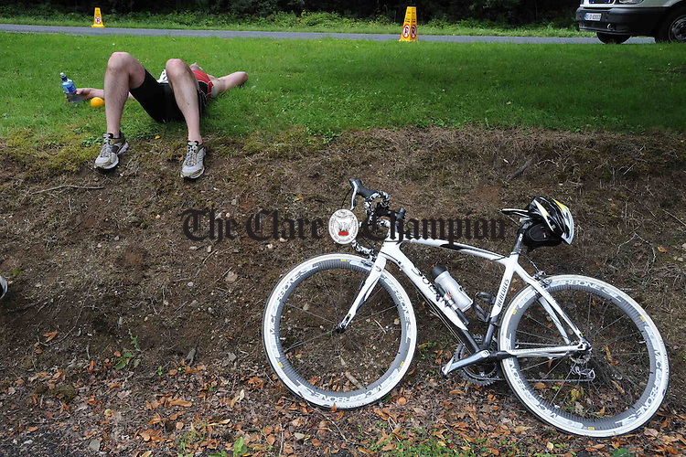 Flat out after competing in the Brian Boru Sprint Triathlon at Two-Mile-Gate,  Killaloe. Photograph by John Kelly.