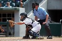 Charlotte Knights catcher Brett Austin (22) sets a target as home plate umpire Ryan Wills looks on during the game against the Indianapolis Indians at BB&T BallPark on August 22, 2018 in Charlotte, North Carolina.  The Indians defeated the Knights 6-4 in 11 innings.  (Brian Westerholt/Four Seam Images)
