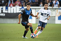 SAN JOSE, CA - AUGUST 25: Shea Salinas #6 of the San Jose Earthquakes and Michaell Chirinos #33 of the Vancouver Whitecaps during a game between Vancouver Whitecaps FC and San Jose Earthquakes at Avaya Stadium on August 24, 2019 in San Jose, California.