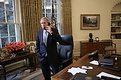 Standing at his desk in the Oval Office in the White House in Washington, D.C., United States President George W. Bush receives a phone call from the Democratic presidential candidate, United States Senator John Kerry (Democrat of Massachusetts) in which the Senator conceded defeat in the 2004 presidential election on Wednesday, November 3, 2004.<br /> Mandatory Credit: Eric Draper / White House via CNP