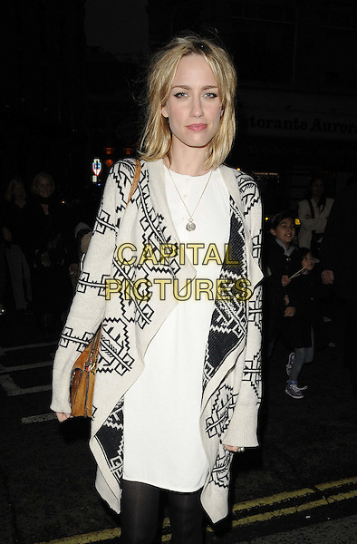 Ruta Gedmintas.The 'Noises Off' press night, Novello Theatre, Aldwych. London, England..April 3rd, 2012.half length white print  dress black jacket.CAP/CAN.©Can Nguyen/Capital Pictures.