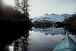 Alaska, Prince William Sound, Sea kayaker explores Port Wells in early spring,