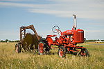 IHC Farmall Model A with rake wheel in tow