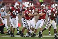 18 November 2006: Jay Ottovegio rushes for a first down and is congratulated by Mike Silva, Clinton Snyder, and Brent Newhouse during Stanford's 30-7 loss to Oregon State at Stanford Stadium in Stanford, CA.