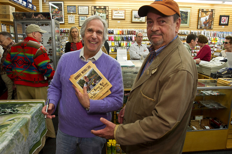 "Actor/director Henry Winkler poses with former KNBC news Director, Bob Long, 67, part of a crowd of over a hundred fans at a book signing for Winklers ""I've Never Met An Idiot on The River"" fly fishing memoir at the Fishermans Spot in the Van Nuys section of Los Angeles Calif., December 11, 2011...Photo Gerard Burkhart.gbpix.photoshelter.com"