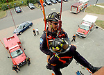East Hartford Conn. Firefighter Robert June hanging by ropes as he brings  fellow firefighter Brian Jennes from a window down the side of   the training tower at East Hartford fire Headquarters during a drill on fire rescuing by ropes, Monday, Oct 1, 2007, in East Hartford.(AP Photo/Journal Inquirer, Jim Michaud)