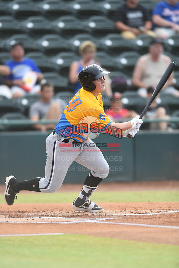 Andrew Vaughn (14) of Los Rapidos de Kannapolis follows through on his swing during a game against Las Llamas de Hickory at L.P. Frans Stadium on July 17, 2019 in Hickory, North Carolina. The Llamas defeated the Rapidos 7-5. (Tracy Proffitt/Four Seam Images)