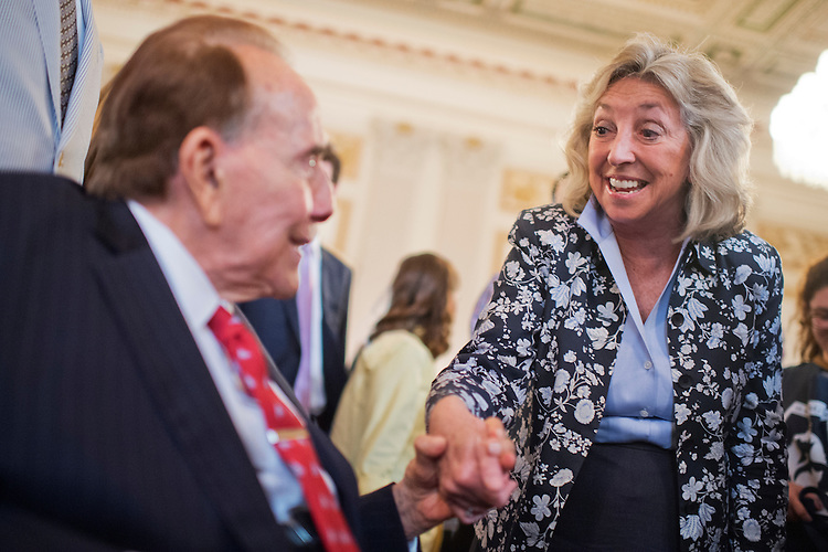 UNITED STATES - JULY 30: Former Sen. Bob Dole, R-Kan., greets Rep. Dina Titus, D-Nev., during the ASPCA's Fourth Annual Paws for Celebration pet adoption event in Cannon Building, July 30, 2015. (Photo By Tom Williams/CQ Roll Call)