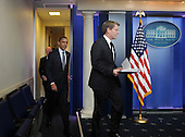 United States President Barack Obama arrives with Press Secretary Jay Carney (R) and Chief of Staff Bill Daley (L) to discuss the 2011 budget impasse with Congress during a quick press conference in the Brady Press Briefing Room of the White House in Washington on Tuesday, April 5, 2011. If Republican and Democratic legislators can not agree on a budget in the next few days the federal government faces a shutdown.    .Credit: Roger L. Wollenberg / Pool via CNP