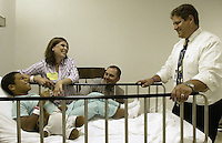 Derick Byrd, left, with his mother Terra and father Matt, laugh at Dr. Joel Mayerson's jokes before going into surgery at Children's Hospital, Friday June 17, 2005, in Columbus, Ohio. Derick's surgery was a non-invasive procedure using an electromagnetic field to create heat that softens a polymer, allowing Derick's plastic and titanium prosthesis to expand.<br />