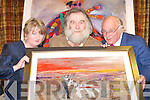 ART EXHIBIT: Bill Griffin (centre) shows Maureen Delaney and James O'Connor one of his paintings at his art exhibition in the Malton Hotel, Killarney, on Friday.   Copyright Kerry's Eye 2008
