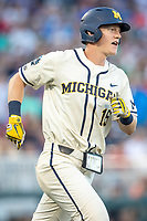 Michigan Wolverines first baseman Jimmy Kerr (15) rounds first base after his seventh inning home run against the Vanderbilt Commodores during Game 1 of the NCAA College World Series Finals on June 24, 2019 at TD Ameritrade Park in Omaha, Nebraska. Michigan defeated Vanderbilt 7-4. (Andrew Woolley/Four Seam Images)