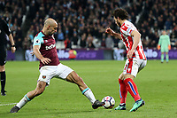 Ramadan Sobhi of Stoke City and Pablo Zabaleta of West Ham United during West Ham United vs Stoke City, Premier League Football at The London Stadium on 16th April 2018