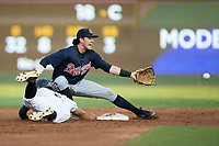 Gwinnett Braves shortstop Dansby Swanson (2) reaches for a throw as Jacob May (8) of the Charlotte Knights dives back into second base at BB&T BallPark on August 4, 2017 in Charlotte, North Carolina.  The Knights defeated the Braves 7-5 in a game shortened to 8 innings due to rain.  (Brian Westerholt/Four Seam Images)