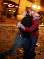 James Hellmuth, 22, of St. Louis, left, and Paul Renner, 21, of University City, embrace on second street at Laclede's Landing after game 5 of the World Series at Busch Stadium. The Cardinals won the game 4-2 and the World Series championship on Friday, October 27, 2006.