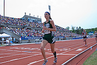 Springfield Catholic junior Kelly Devlin finishes her second lap of four enroute to a 10th place finish in the Class 3 Girls 1600 meters in 5:20.46.