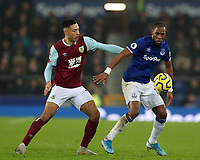 26th December 2019; Goodison Park, Liverpool, Merseyside, England; English Premier League Football, Everton versus Burnley; Djibril Sidibe of Everton controls the ball under pressure from Dwight McNeil of Burnley - Strictly Editorial Use Only. No use with unauthorized audio, video, data, fixture lists, club/league logos or 'live' services. Online in-match use limited to 120 images, no video emulation. No use in betting, games or single club/league/player publications