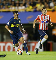"BUENOS AIRES - ARGENTINA - 04 - 04 - 2018: Cristian Pavon   (Izq.) jugador de Boca Juniors disputa el balón con Leonardo Pico (Der.) jugador de Atletico Junior, durante partido de la fase de grupos, grupo H, fecha 2, entre Boca Juniors (ARG) y Atletico Junior (Col) por la Copa Conmebol Libertadores 2018, jugado en el estadio Alberto J. Armando ""La Bombonera""  de la ciudad Ciudad Autónoma de Buenos Aires. / Cristian Pavon   (L) player of Boca Juniors vies for the ball with Leonardo Pico (R) player of Atletico Junior, during a match of the groups phase, group H, of the 2nd date between Boca Juniors (ARG) and Atletico Junior (Col), for the Copa Conmebol Libertadores 2018 at the Alberto J. Armando ""La Bombonera"" Stadium in Ciudad Autónoma de Buenos Aires. Photo: VizzorImage / Javier Garcia Martino / Photogamma / Cont."