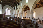 Interior of historic wooden pews,  wooden roof beams, whitewashed walls and columns, All Saints church, South Elmham, Suffolk, England, UK, church in In the care of the Churches Conservation Trust.