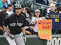 Ichiro Suzuki (Yankees),<br /> JUNE 6, 2013 - MLB :<br /> Fans cheer Ichiro Suzuki of the New York Yankees with a sign and an Orix BlueWave #51 shirt during the Major League Baseball game against the Seattle Mariners at Safeco Field in Seattle, Washington, United States. (Photo by AFLO)