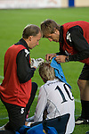 Bangor City 0 FC Honka 1, 23/07/2009. Racecourse Ground, Europa League. Jami Puustinen of Finland's FC Honka receives stitches to a head wound from his team medical team at Wrexham's Racecourse Ground during his sides Europa League second round second leg tie against Welsh club Bangor City. The match had to be staged away from City's Farrar Road ground as it did not meet UEFA's stadium standards. The Finns won 1-0 in Wales to go through 3-0 on aggregate in front of 602 spectators in the first season of the newly-introduced competition which replaced the UEFA Cup. Photo by Colin McPherson.