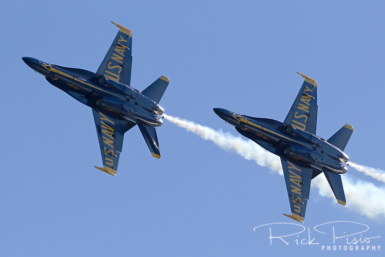 Pair of Blue Angels aircraft pass overhead.