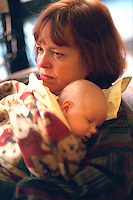 Grandmother age 57 holding newborn grandson after delivery.  Minneapolis Minnesota USA
