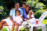 African american family outside at home.