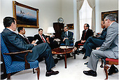 United States President Ronald Reagan meets with senior members of the National Security Council (NSC) staff on Tuesday, March 3, 1987 in the National Security Advisor's Office in the White House in Washington, D.C. Seated, from left: Vice President George H.W. Bush; Lieutenant General Colin Powell, Deputy National Security Advisor; President Reagan; Frank Carlucci, National Security Advisor; White House Chief of Staff Howard Baker; Grant Green, Executive Secretary, National Security Council; Ambassador Henry Cohen, member of the NSC staff.  The meeting included discussion on southern Africa, particularly Angola and Mozambique. .Mandatory Credit: Bill Fitz-Patrick - White House via CNP