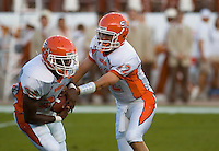 30 September 2006: Sam Houston State quarterback Brett Hicks (#12) hands off to running back D.D. Terry (#34) during the Bearkats 56-3 loss to the University of Texas Longhorns at Darrell K Royal Memorial Stadium in Austin, TX.