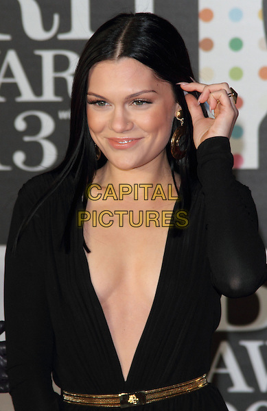 Jessie J (Jessica Ellen Cornish).Arrivals for The 2013 Brit Awards at the O2 Arena, London, England..February 20th 2013.BRITS half length black low cut dress gold belt long sleeve plunging neckline cleavage hand arm.CAP/ROS.©Steve Ross/Capital Pictures