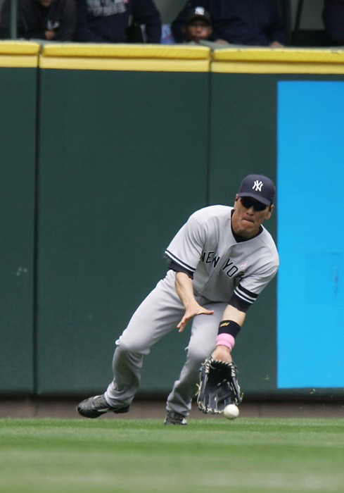 13 May 2007: Hideki Matsui fields a grounder to left field during the Yankees 2-1 loss to the Seattle Marinersat Safeco Park in Seattle, Washington.