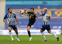 Manchester City's Bernardo Silva (centre) battles with  Brighton & Hove Albion's Davy Propper (left) and Aaron Mooy (right) <br /> <br /> Photographer David Horton/CameraSport<br /> <br /> The Premier League - Brighton & Hove Albion v Manchester City - Saturday 11th July 2020 - The Amex Stadium - Brighton<br /> <br /> World Copyright © 2020 CameraSport. All rights reserved. 43 Linden Ave. Countesthorpe. Leicester. England. LE8 5PG - Tel: +44 (0) 116 277 4147 - admin@camerasport.com - www.camerasport.com