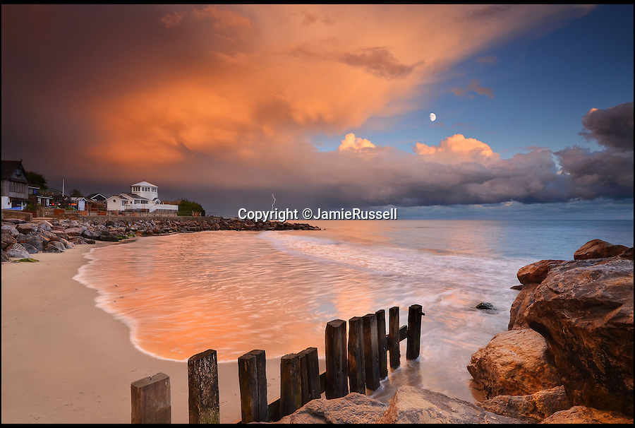 BNPS.co.uk (01202 55883£)<br /> Pic: JamieRussell/BNPS<br /> <br /> ***Please Use Full Byline***<br /> <br /> Steephill Cove, evening storm<br /> <br /> Stunning photographs have revealed a turbulent side to the normally genteel Isle of Wight.<br /> <br /> The seemingly benign south coast holiday destination has been catalogued over a stormy year by local photographer Jamie Russell, and his astonishing pictures reveal the dramatic changes in weather that roll across the UK in just 12 months.<br /> <br /> Lightning storms, ice, floods, gales and blizzards have all been captured by the intrepid photographer who frequently got up in the middle of the night to capture the climatic chaos.<br /> <br /> Looking at these pictures prospective holidaymakers could be forgiven for thinking twice about a gentle staycation on the south coast island.