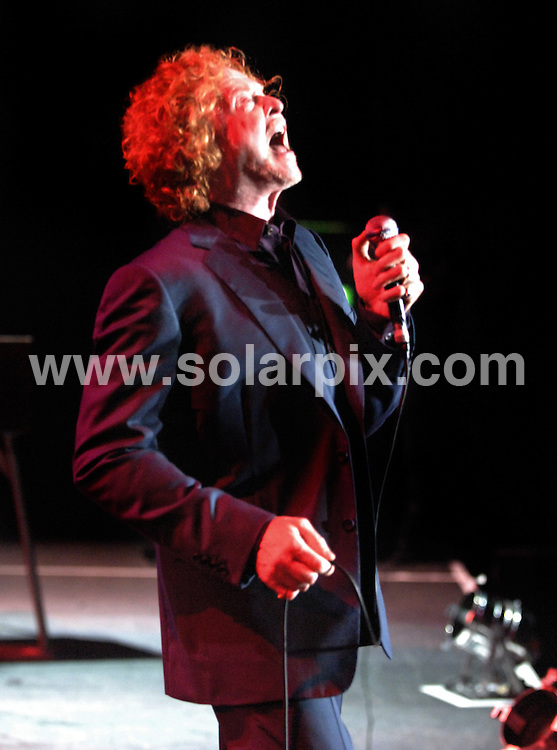 **ALL ROUND PICTURES FROM SOLARPIX.COM**.**WORLDWIDE SYNDICATION RIGHTS**.Mick Hucknall singing with Simply Red as they perform in Liverpool, UK. 25 July 2009..This pic: Mick Hucknall..JOB REF: 9614 SGD     DATE: 25_07_2009.**MUST CREDIT SOLARPIX.COM OR DOUBLE FEE WILL BE CHARGED**.**MUST NOTIFY SOLARPIX OF ONLINE USAGE**.**CALL US ON: +34 952 811 768 or LOW RATE FROM UK 0844 617 7637**