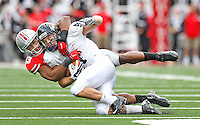 Ohio State Buckeyes linebacker Darron Lee (43) takes down Kent State Golden Flashes running back Nick Holley (4) in first half action at Ohio Stadium on September 13, 2014.  (Chris Russell/Dispatch Photo)