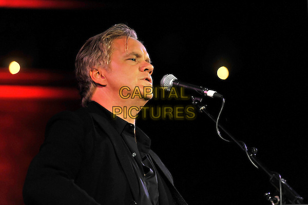 TIM ROBBINS AND THE ROGUES GALLERY BAND.Tim Robbins & The Rogues Gallery Band performing live at the Union Chapel, London, England..September 30th, 2010.stage concert live gig performance music half length black jacket singing headshot portrait profile .CAP/MAR.© Martin Harris/Capital Pictures.