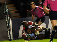 Heineken Cup. London, England. Jordan Turner-Hall of Harlequins dives over for a try during the Heineken Cup Pool 3 match between Harlequins and Biarritz Olympique at Twickenham Stoop on October 13, 2012 in London, England.