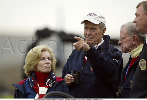 Ex American President GEORGE BUSH (USA) watches the action, Fourball Match, 34th Ryder Cup, The Belfry, Sutton Coldfield, 020928. Photo: Glyn Kirk/Action Plus....2002.presidents.golf