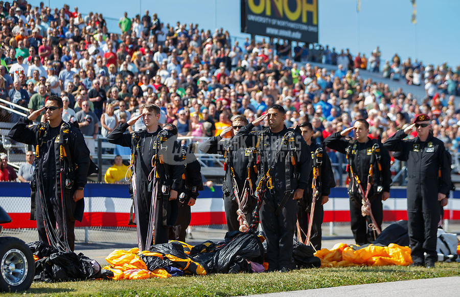 Sep 2, 2017; Clermont, IN, USA; Members of the US Army Golden Knights precision parachute team stand and salute during the national anthem prior to NHRA qualifying for the US Nationals at Lucas Oil Raceway. Mandatory Credit: Mark J. Rebilas-USA TODAY Sports