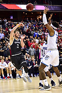 Washington, DC - MAR 11, 2018: Davidson Wildcats guard Jon Axel Gudmundsson (3) jumps and passes the ball over Rhode Island Rams guard E.C. Matthews (0) during the Atlantic 10 men's basketball championship between Davidson and Rhode Island at the Capital One Arena in Washington, DC. (Photo by Phil Peters/Media Images International)