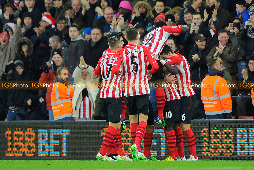Sadio Mane of Southampton gets mobbed by his Southampton team mates after scoring - Southampton vs Arsenal - Barclays Premier League Football at St Mary's Stadium, Southampton, Hampshire - 01/01/15 - MANDATORY CREDIT: Denis Murphy/TGSPHOTO - Self billing applies where appropriate - contact@tgsphoto.co.uk - NO UNPAID USE