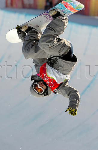 13 February 2006: Norwegian snow-boarder Kjersti Buaas, (NOR) performs an aerial on her way to third place in the Ladies Snowboard Halfpipe competition in Bardoncchia. Photo: Glenn Campbell/actionplus*** NO SALES JAPAN & GERMANY***...extreme winter snowboarding women woman female 060213